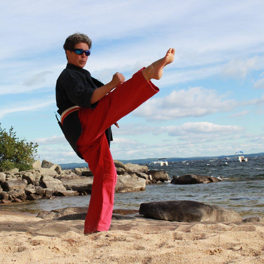 Renshi Lisa executes Mae Geri, or Front Kick, on the shore of Sebago Lake in Standish, Maine.